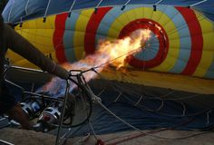 Hot air ballon burner heater. Detail on a member of the crew of a hot air ballon inflating the ballon before a demostration flight airshow in Palma de Mallorca stock photography