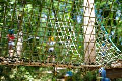 Mesh obstacle detail in green forest adventure playground Royalty Free Stock Image