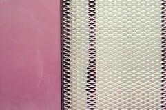 Detail of metal door. Pink metal door with texture Royalty Free Stock Image