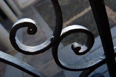 Detail of a metal gate black white. Metal curls - metal gate - wrought iron manually Stock Photos