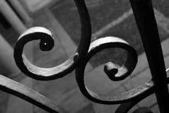 Detail of a metal gate black white. Metal curls - metal gate - wrought iron manually Royalty Free Stock Images