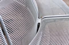 Detail of a metal park bench royalty free stock image