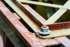 Detail of metal screw on partly rusted metal parts. Stock Photos