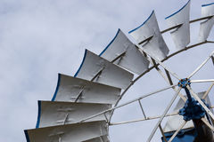 Detail of metal wind wheel in the Texas prairie. Single silver and blue wind wheel in the Texas Panhandle up close and in detail Stock Photos