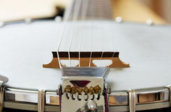 Detail of a metallic banjo 6 strings as music background Royalty Free Stock Photography