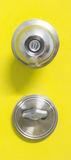 Detail of a metallic knob on yellow door , tainless steel round ball door knob Royalty Free Stock Image