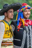 Detail of a Mexican and Turkish folk costumes. TIMISOARA, ROMANIA - JULY 8, 2018: Detail of a Mexican and Turkish folk costumes, at two young dancers who changed stock photos