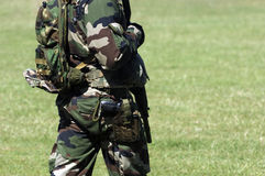 Detail of military uniform. Detail of french military uniform with gun Royalty Free Stock Image