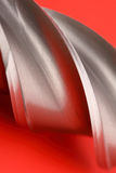 Detail of milling cutter. On red Royalty Free Stock Photo