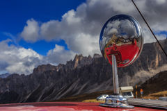 Detail of mirror from old car in Passo Giau stock photography