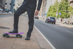 Detail of a model posing with his skateboard Royalty Free Stock Images