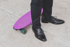Detail of a model posing with his skateboard Royalty Free Stock Photo