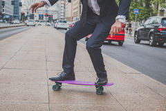 Detail of a model posing with his skateboard Royalty Free Stock Image
