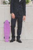 Detail of a model posing with his skateboard Royalty Free Stock Photos