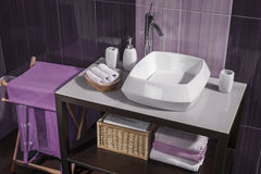 Detail of a modern bathroom with white sink and accessories Stock Images