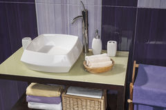 Detail of a modern bathroom with white sink and accessories Royalty Free Stock Image