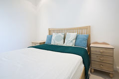 Detail of a modern bedroom. With decorative elements and bedside tables Stock Images
