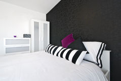 Detail of a modern bedroom with king size bed stock photography