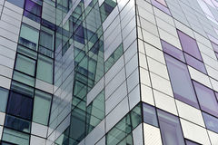 Detail of modern building exterior. Interesting angles and unexpected window placement adorn this contemporary condo building in New York royalty free stock image