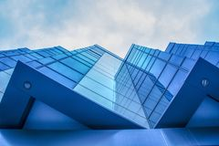 Detail of modern building exterior and reflection Royalty Free Stock Photo