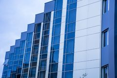 Reflections in the glass of modern building exterior Stock Photos