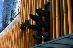 Detail of modern building with pipes. Detail of e of modern building with pipes and exhaust sticking out stock photo