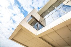 Detail of a modern concrete building with glass windows royalty free stock image