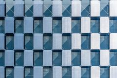 Detail of modern curtain wall facade. Checkerboard design. Detail of modern curtain wall facade in skyscraper in Madrid. Checkerboard design royalty free stock images