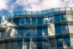 Detail of Modern Glass Building with Reflected Sky in Berlin Royalty Free Stock Images
