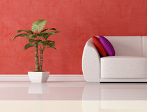 Detail of a modern interior. Detail of a modern couch with cushion and plant in front a plaster red wall Royalty Free Stock Photo