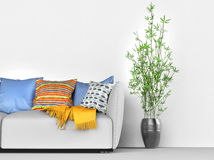Detail of the modern living room. Sofa and house plant Royalty Free Stock Photos
