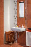Detail of modern private bathroom interior in orange with floral Stock Photo