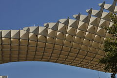 Detail of a modern roof of a contemporary building in Sevilla Spain made of wooden and iron boards as a symbol of futuristic arc. Detail of a modern roof of a Royalty Free Stock Image