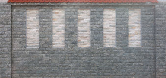 Detail of modern stone wall with red tiled roof Stock Photos
