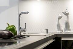 Detail of modern white kitchen interior design. Detail of modern white kitchen clean interior design Stock Image