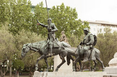 Detail of the monument to Cervantes. Don Quixote and Sancho Panza. Madrid. Spain. Royalty Free Stock Photo