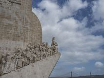 Detail of the monument to the discoveries with the bridge XXV Ap royalty free stock photos