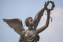 Detail of monument to goddess of victory Nike against the sky. Royalty Free Stock Photography