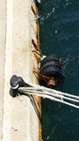 Detail of mooring a boat to port Royalty Free Stock Photography