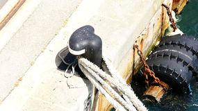 Detail of mooring a boat to port Stock Images