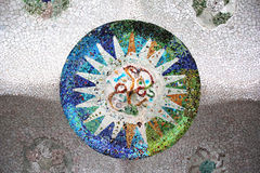 Parc Guell Mosaic. Detail of a mosaic that adorns the wall in  Gaudi's Parc Guell, Barcelona, Spain Stock Image