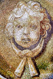 Detail of the mosaic shows the head of a child angel Stock Photography