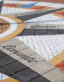 Detail of Mosaic Tile Compass. A detail of a wind rose or compass set into the ground Stock Photography