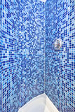 Detail of a mosaic tiled shower. In blue Royalty Free Stock Photo