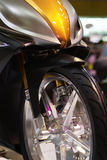 Detail of motorbike. Including front wheel Royalty Free Stock Photography