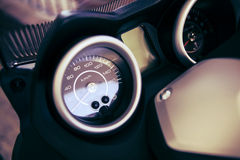 Detail of motorbike speedometer. Vintage tone. Royalty Free Stock Images