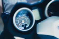 Detail of motorbike speedometer. Zoom effect. Fast speed feeling effect. Royalty Free Stock Photo