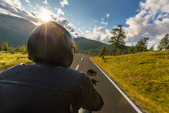 Detail of motorcycle driver. Outdoor photography, Alpine landscape. royalty free stock photography