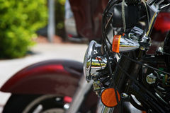 Detail of motorcycle front end with headlight Royalty Free Stock Images