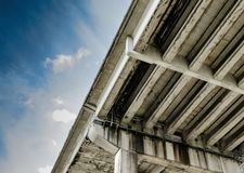 Detail of a motorway superstructure seen near the Channel Tunnel in the UK. Showing the stressed concrete design and large pillars, seen here spanning a large Stock Photo